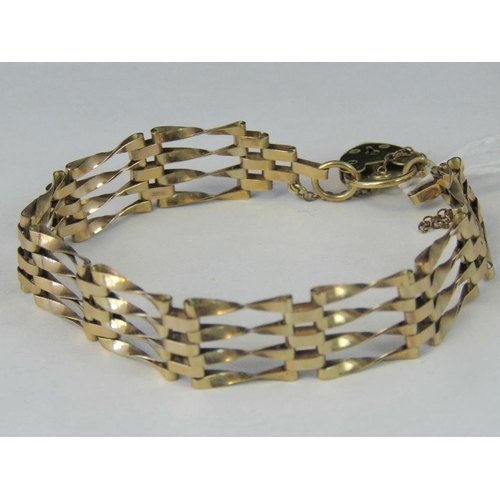 233 - A 9ct gold four bare gate bracelet, heart padlock clasp hallmarked 375, 9.17g...