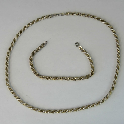235 - A silver and yellow metal rope and box link necklace and bracelet set, silver rope chain twisted wit...