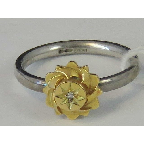 240 - A silver and yellow metal ring, yellow metal head set with diamond chip on a white metal shank hallm...