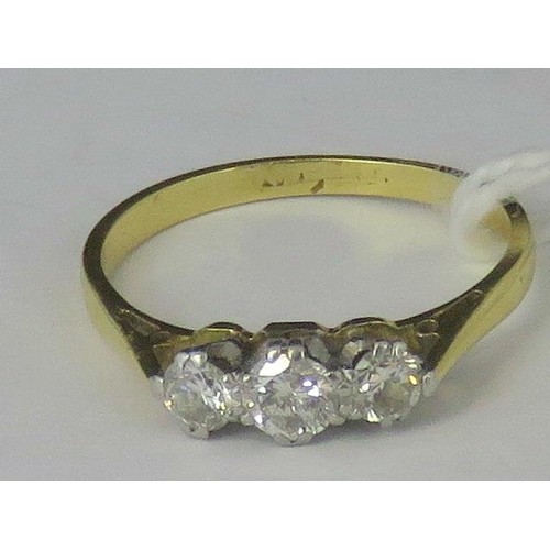 243 - A yellow metals three stone diamond ring, three graduated diamonds approx 0.35cts total, claw set in...