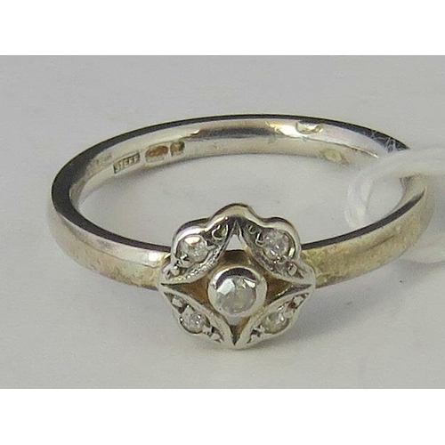 245 - A silver ring set with five diamond chips, hallmarked 925, size K - L,  2.43g...