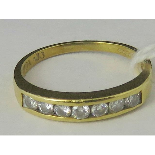 246 - An 18ct gold and diamond ring, seven channel set round diamonds, 0.33ct total weight, all set in yel...