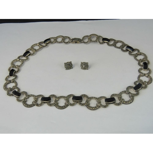 247 - A silver marcasite and onyx necklace, hallmarked 925, with a pair of 925 silver marcasite stud earri...