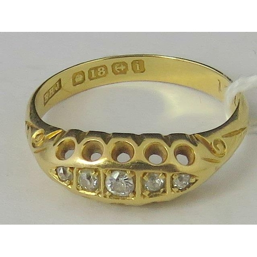 248 - An 18ct gold and diamond ring, five graduated diamonds set in yellow metal hallmarked 18, size O, 3....