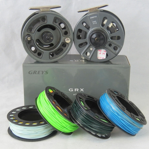 155 - Two Greys GRX 7/8 fly reels, 100mm diameter, with six spools loaded with various floating/sinking fl...