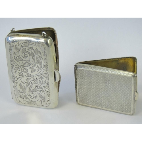17 - A HM silver match case, London 1934, maker S J Rose & Son,  6.3cm high, together with a HM silver ch...