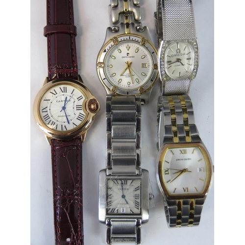 366 - Five watches; two Pierre Cardin and three replica watches (one a/f)...