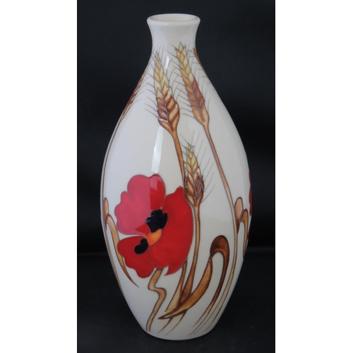 490 - A Moorcroft vase with Harvest Poppy design, 24cm high....