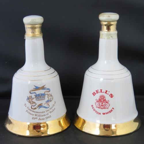 500 - Two Wade commemorative whisky bells dated 1982 and 1984, both sealed with contents....