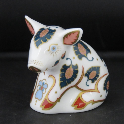 507 - A Royal Crown Derby paperweight fashioned as a piglet 'Snuffle', 8cm high with silver button to base...