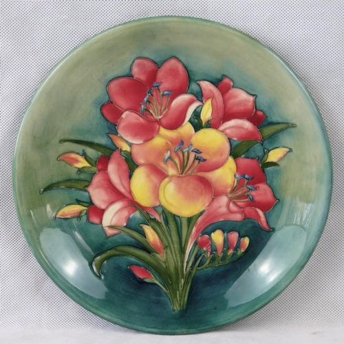 515 - A Walter Moorcroft African Lily charger c1950s, 27cm dia, chip to base....