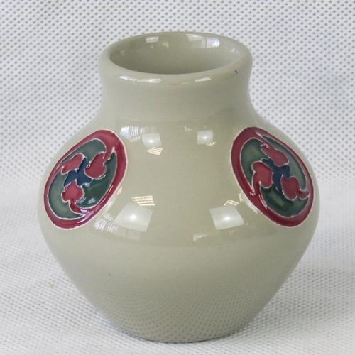 519 - A Moorcroft vase with Flamminian design, 9cm high....