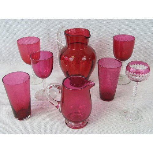 620 - An etched cranberry drinking glass dated 1899 together with five other glasses and two cranberry gla...