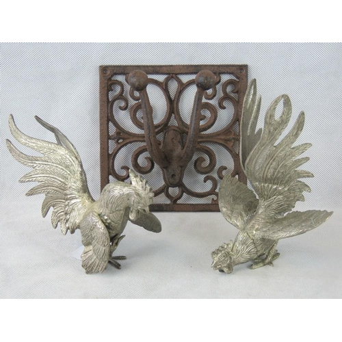 622 - A pair of white metal fighting cocks, 20cm, and an ornate iron coat hook, 17cm....