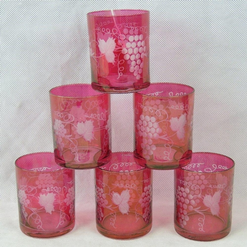 624 - A set of six cranberry to clear cut glass tumblers decorated with grapes and vines, 9cm high....