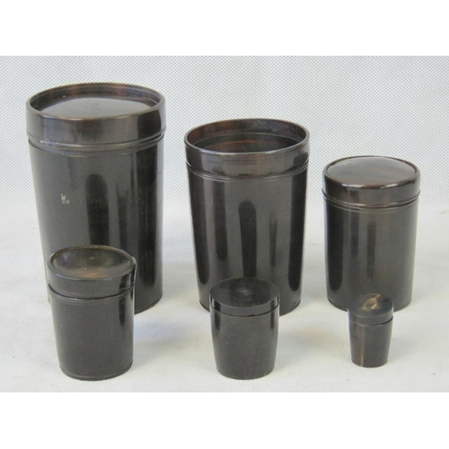 691 - A set of six concentric Bakelite cups, five with lids; largest 12.5 cm high smallest 3cm high....