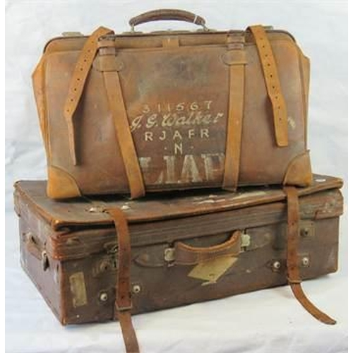 692 - A large vintage leather portmanteau case together with a demob type strap case with inscription conn...