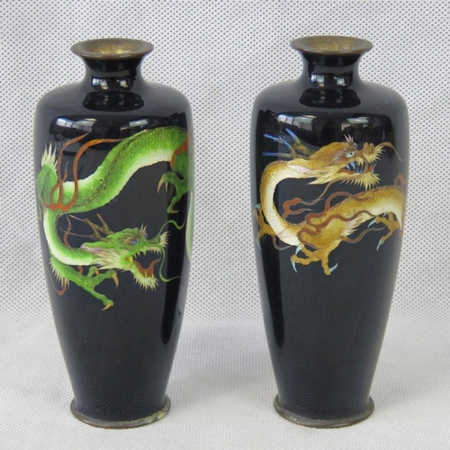 695 - A pair of 20th century cloisonné vases with Chinese dragons; each 15cm high....