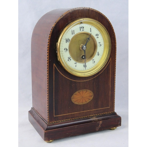 907 - An Edwardian dome topped mantle clock with inlaid mahogany case, 28cm high, a/f....