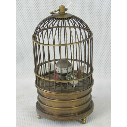909 - A reproduction brass bird cage clock, 16cm high....