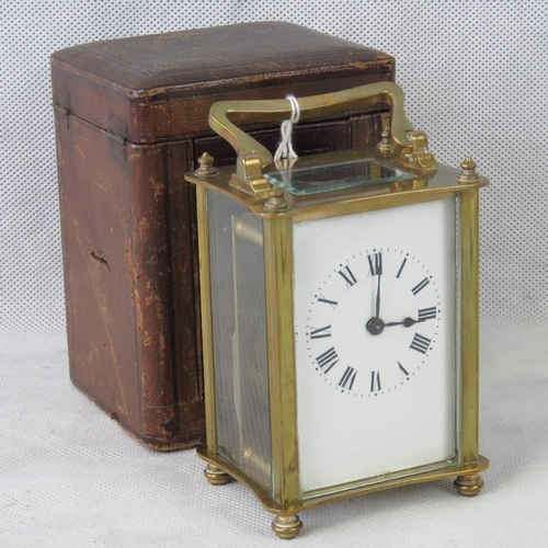 910 - An early 20th century French made carriage clock with Roman numeral dial and original leather case....