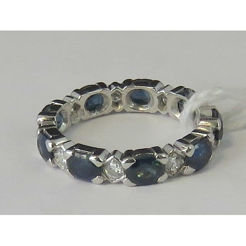 256 - A white metal sapphire and diamond eternity ring, marquise cut sapphires alternating with diamonds a...