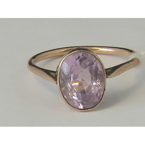 259 - A rose metal and amethyst ring, oval amethyst set in rose metal, unmarked, size L - M, a/f split to ...