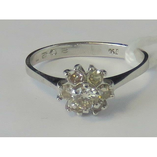 261 - An 18ct white gold and two tier diamond cluster ring, central diamond approx 0.15cts surrounded by a...