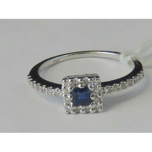 262 - An 18ct white gold sapphire and diamond ring, square cut sapphire approx 0.16ct surrounded by a gall...