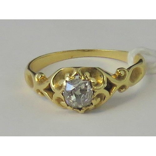 263 - A yellow metal and diamond gypsy ring, diamond approx 0.3cts set in yellow metal scrolling design sh...