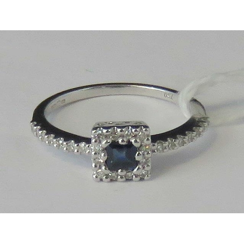 268 - An 18ct white gold sapphire and diamond ring, square cut sapphire approx 0.16ct surrounded by a gall...