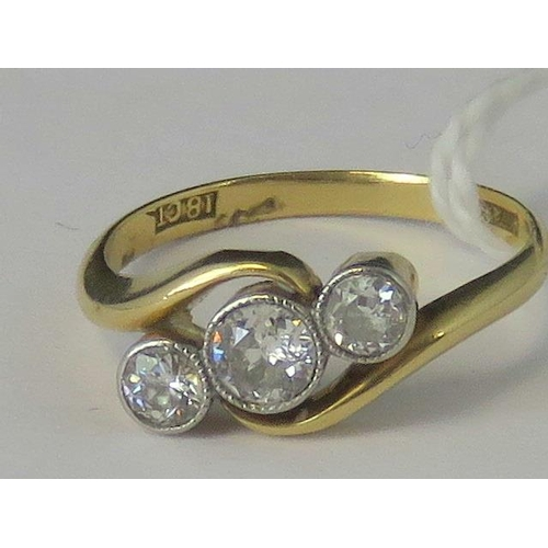 269 - A vintage 18ct gold and three stone diamond ring, three graduated diamonds approx 0.45cts total, in ...