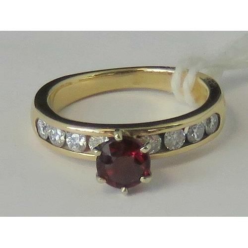 270 - A yellow metal ruby and diamond ring, central round ruby approx 0.35cts flanked by four channel set ...