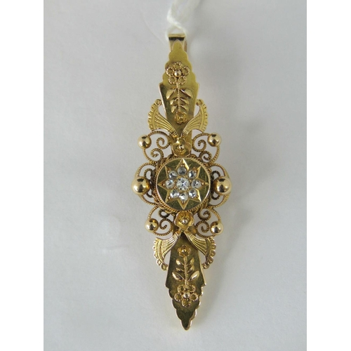 271 - A 15ct gold and diamond pendant, central panel set with diamonds in star formation, surrounded by fi...