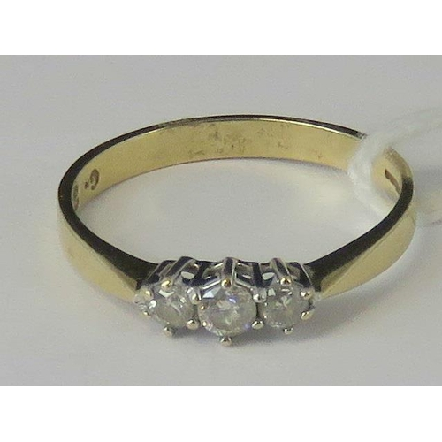 275 - An 18ct gold three stone diamond ring, graduated diamonds 0.35ct total weight, set in white metal on...