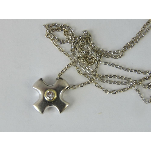 276 - An 18ct white gold Maltese cross style pendant set with a single diamond approx 0.1ct, hallmarked 75...