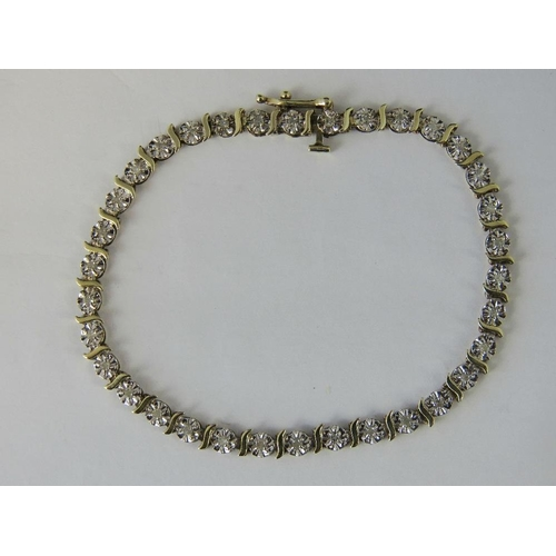 277 - A 9ct gold and diamond tennis bracelet, thirty four articulated sections each set with a diamond chi...