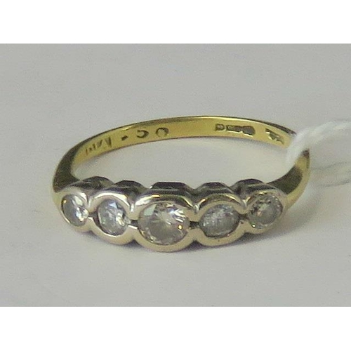 280 - An 18ct gold and five stone diamond ring, graduated diamonds 0.5ct total, in rub over white metal se...
