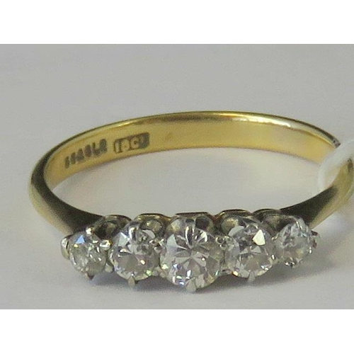 282 - An 18ct gold five stone diamond ring, graduated diamonds approx 0.49cts total weight, set in white m...