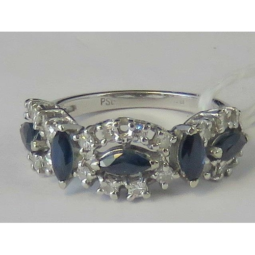 283 - A white metal sapphire and diamond ring, five marquise cut sapphires, three are transverse set and w...