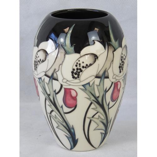 525 - A Moorcroft large Talwain vase by Nicola Slaney, 18cm high....