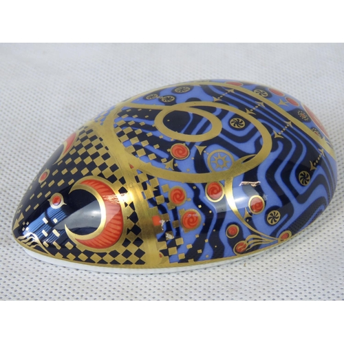 526 - A Royal Crown Derby paperweight fashioned as a mouse with gold button, 11cm long....