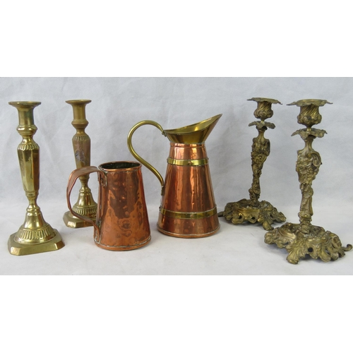 628 - A copper water jug (23.5cm high) and vase also two pairs of brass candlesticks....