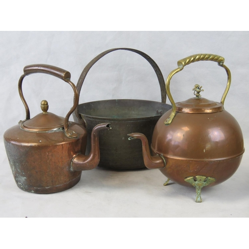 629 - A Victorian heavy copper preserve pan with iron handle, together with two copper kettles....