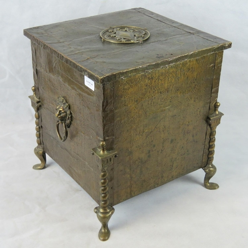636 - An early 20th century log bin with brass sheet. Covering and fittings and cast iron metal liner; rai...