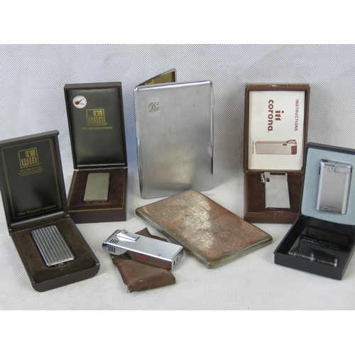 700 - Five retro cigarette and pipe lighters: i11 corona; Win; WKS together with two vintage plated cigare...