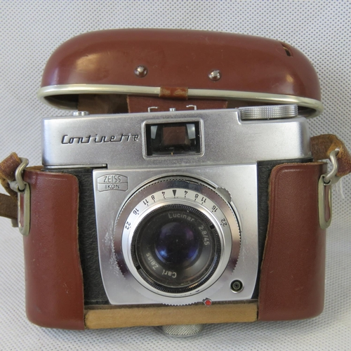 838 - A vintage Continette camera with Zeiss lens and original pig skin leather case....