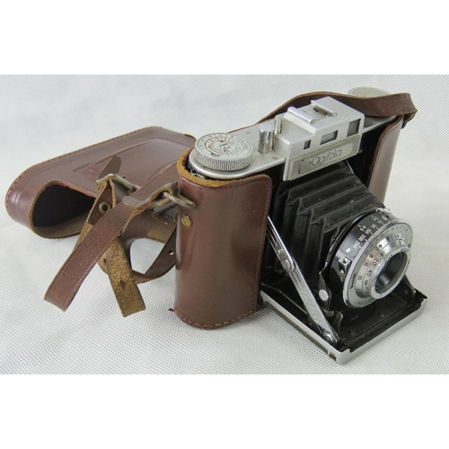 839 - A collection of retro camera equipment with camera bag: a Petri TTL camera; a Carl Zeiss electric MC...
