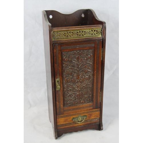 1157 - A Victorian mahogany hanging cabinet with interior pipe rack; stamped ''RD No. 215649''; 51.5cm high...