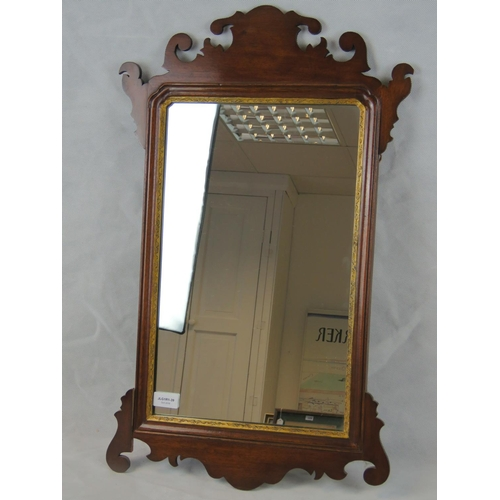1162 - A reproduction Georgian silhouette framed mirror; 70cm high....